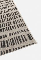 Hertex Fabrics - Coding outdoor rug - ink