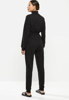 Missguided - Roll neck drop shoulder jumpsuit - black