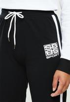 SISSY BOY - Sweat pants - black