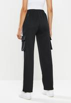 SISSY BOY - Track pants with zippable ankle areas - black & lilac