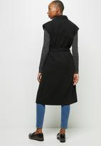 edit - Sleeveless belted coat - black