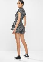 Missguided - Dalmatian print skort belted playsuit - black & white