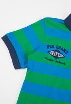 MINOTI - Striped polo top - blue & green