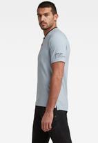 G-Star RAW - Baseball collar graphic short sleeve slim polo - faze blue