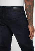 GUESS - Slim straight stretch denim - dark blue