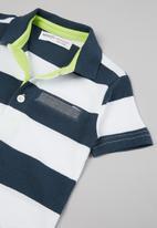 MINOTI - Striped pique polo shirt - navy & white