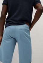 MANGO - Roller bermuda shorts - light blue