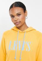 Levi's® - Graphic sport hoodie serif logo hoodie - yellow