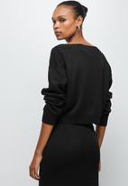 edit - Slash neck jumper - black