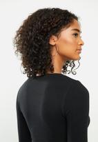 Blake - Soft touch wrap crop top - black
