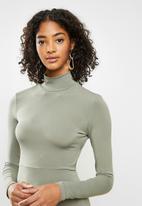 Blake - Open back bodycon turtleneck mini dress - green tea