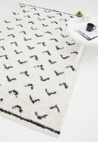 Fotakis - Gipsy shaggy rug - triangle white/black
