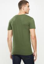 S.P.C.C. - Abram straight hem tee - green