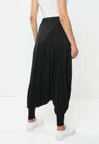 AMANDA LAIRD CHERRY - Harem pants - black