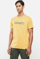 Lee  - American denim brand - yellow