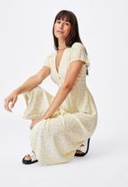 Cotton On - Woven indi short sleeve v-neck button through midi - yellow