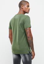 S.P.C.C. - Forester side slit straight hem tee - green