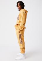 Factorie - Relaxed graphic trackpant - golden sand marle