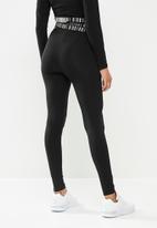 SISSY BOY - Basic leggings with white print logo wide yoke branded elastic - black