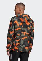 adidas Performance - Own the run jacket  - legacy green/app signal orange/black