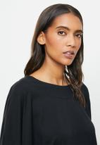STRONG by T-Shirt Bed Co. - Ladies oversized sweat - black