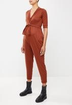 Superbalist - Belted nursing jumpsuit - rust