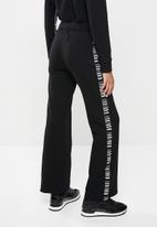 SISSY BOY - Flared sweatpants - black