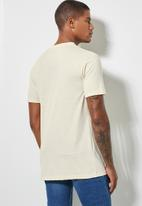 Superbalist - Nate recycled embroidered graphic tee - stone
