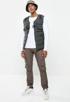Cutty - Jacket sleeveless - fatigue