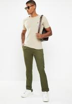 Jonathan D - Trousers with front pleats and side entry pockets - olive