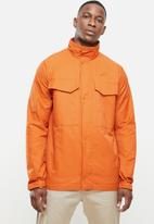 Nike - Nike M65 jacket - orange