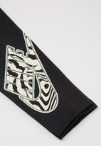 Nike - Nkg electric zebra legging - black