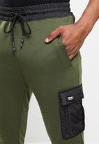 SOVIET - Harden track pants - olive