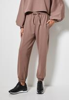 VELVET - Slouch fleece tapered leg track pant - brown