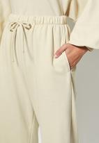 VELVET - Slouch fleece tapered leg track pant - cream