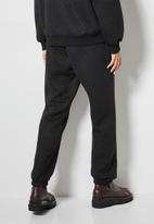Superbalist - Quilted track pants - black
