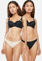 Sissy Boy - Lace thong 2 Pack - Nude and black