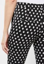 MANGO - Trousers cola - black & beige