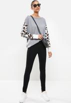 Revenge - Animal print sleeve slouchy jumper - grey