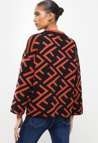 Revenge - Geo print wide sleeve pullover jumper - burnt orange & black