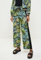 SISSY BOY - Natural printed pants - green