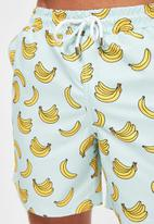 Trendyol - Banana printed swim shorts - green