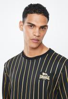 Lonsdale - Lg striped trackset - black & gold