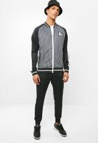 Lonsdale - Raglan sleeves tracksuit - black & white
