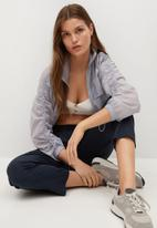 MANGO - Trousers fluido - navy