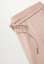 MANGO - Trousers fluido - light pastel pink