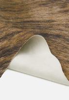 Sixth Floor - Faux cow hide rug - brown & white