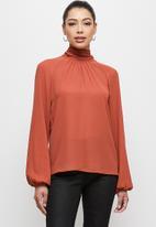 MILLA - Raglan turtle blouse with tie - rust