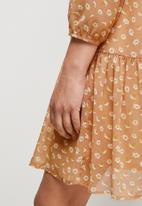 MILLA - Daisy print drop waist mini dress - Sand