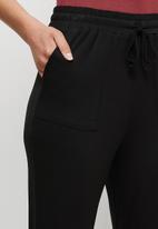 edit - Knit Toggle cuffed jogger - black